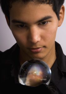 Man stares into a crystal ball to see the future