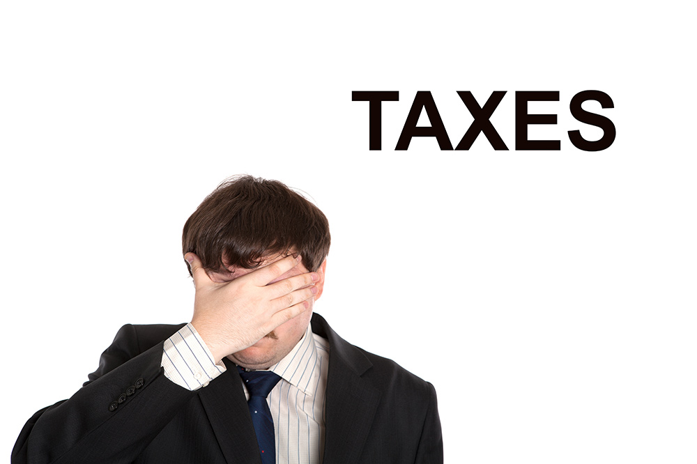 Taxes have a man holding his head